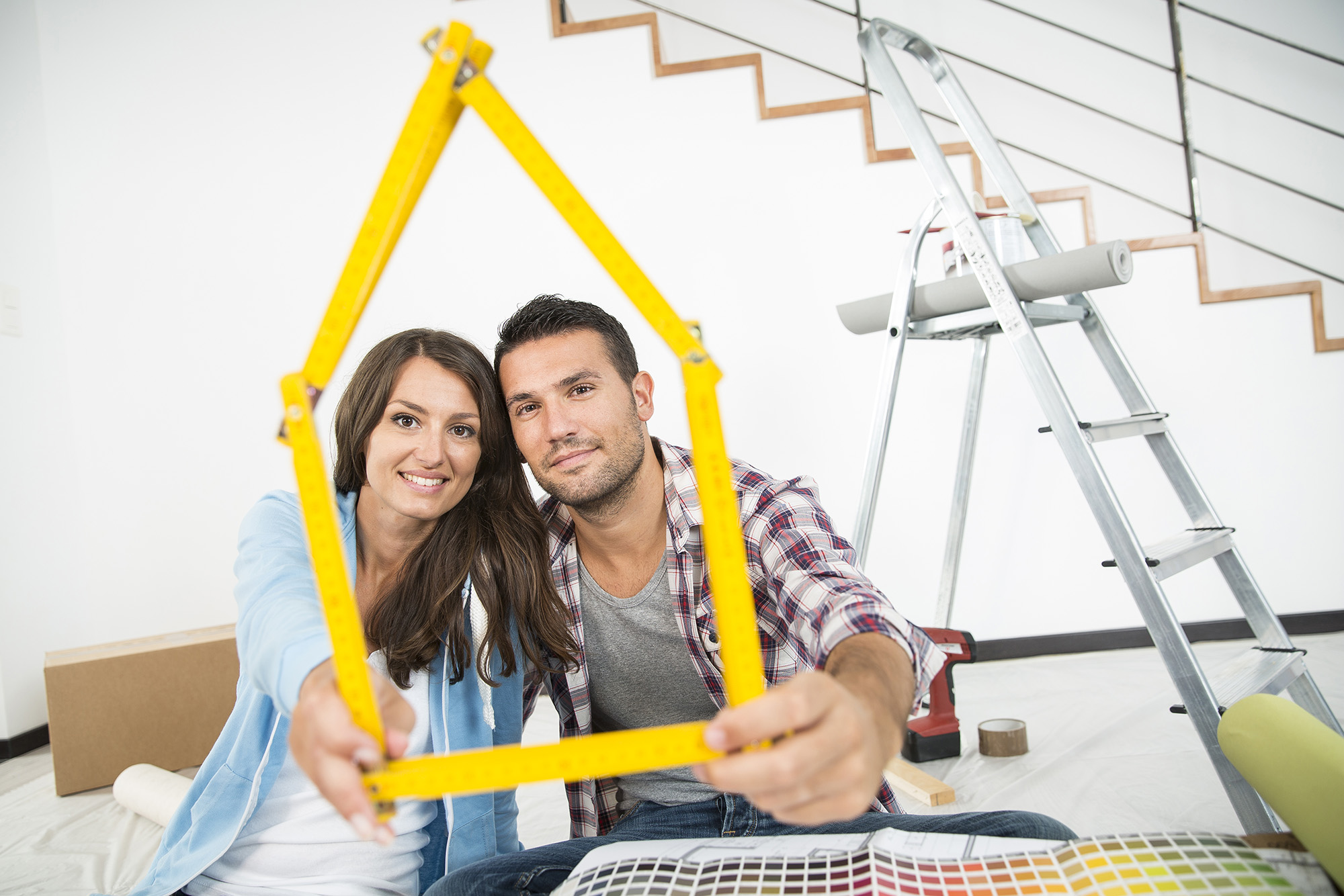couple in new home choosing wall paint colors